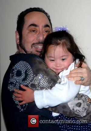 David Gest and Isabella Costello, a downs syndrome child photocall at the Grosvenor House Hotel for The Cauldwell Ball, showing...