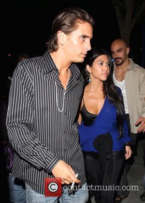 Kourtney Kardashian and a friend