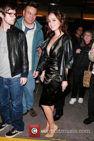 Eliza Dushku in town for the FOX TV Upfront, signing autographs for fans while leaving her hotel New York City,...