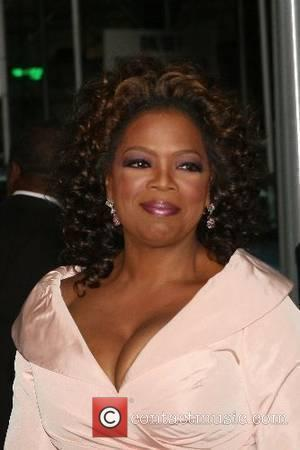 Oprah Defends Author Frey With News Show Phone-In