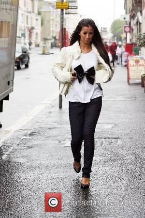 Chantelle Houghton getting caught in the rain whilst going for a coffee with husband Samuel Preston Brighton, England - 21.05.07