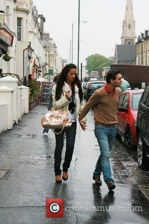 Chantelle Houghton and Samuel Preston getting caught in the rain whilst going for a coffee Brighton, England - 21.05.07