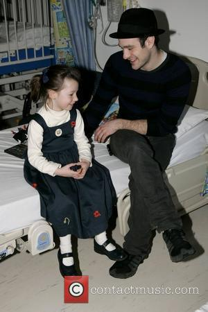 Charlie Cox, the star of movie Stardust, visits the children's ward at St. Mary's Hospital with an ambassador of the...