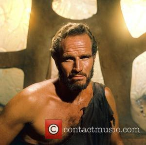 Charlton Heston's Publicist Triumphs In Stamp Campaign