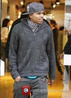 Chris Brown leaving the Dolce & Gabbana store in Mayfair. The American singer will be performing a series of concerts...