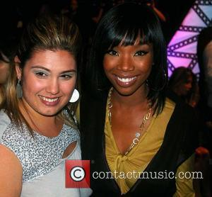 Brandy and Guest Mercedes-Benz Fashion Week 2008 at Smashbox Studios - Christian Audigier - Arrivals Culver City, California - 16.10.07
