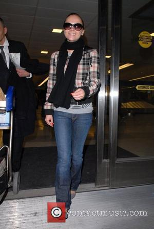 Christina Ricci and her dog, Ramon, arrive from Los Angeles to JFK Airport. New York, USA - 26.02.08