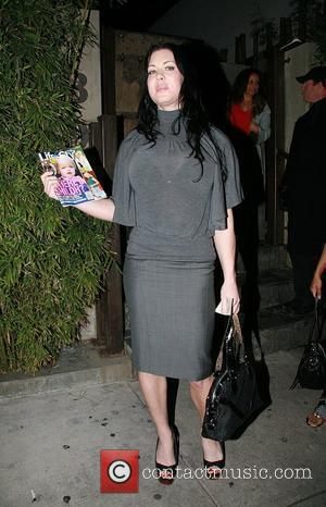 Joan Marie Laurer aka Chyna Doll leaving Koi holding Life & Style magazine. Los Angeles, California - 16.01.08