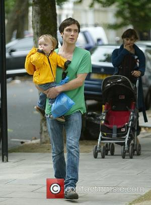 Cillian Murphy goes out with his son to the buy some groceries, wearing an anorak in case of rainfall London,...