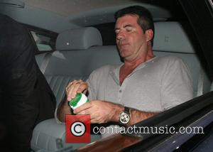 Cowell Cuts Back On Criticism