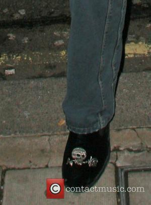 Flavio Briatore arriving at Cipriani restaurant wearing slippers embroidered in silver thread of a skull and rose London, England -...