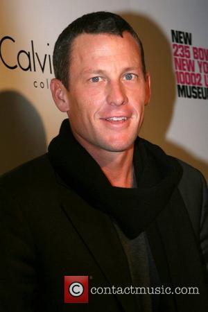 Armstrong Settles Libel Case