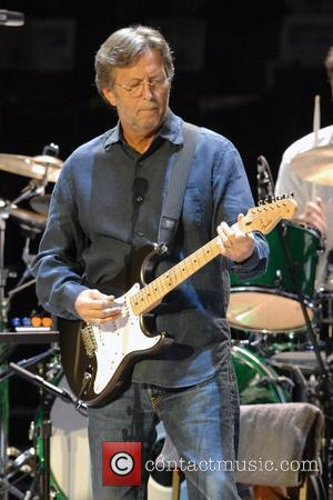 Clapton Tries To Dodge Guitar Legend Tag