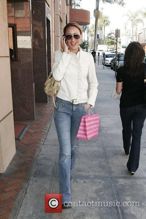 Bring It On actress Clare Kramer talking into her cellphone while arriving at a medical center in Beverly Hills Los...
