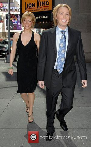 Clay Aiken and friend leaving the New Amsterdam theatre after going to see the musical 'The Lion King' New York...