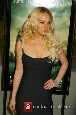 Lohan Tries To Quit Drinking