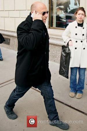 Psych actor Corbin Bernsen talks into his cellphone while out and about in Manhattan New York City, USA - 26.03.08