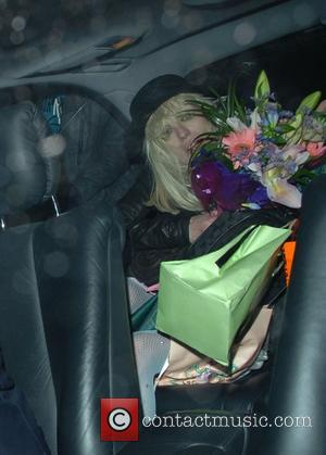 Courtney Love celebrating her 43rd birthday with Noel Fielding leaving Bush Hall after playing her gig London,England - 09.07.07