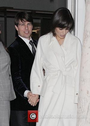 Tom Cruise and wife Katie Holmes leaving the Cut restaurant in The Beverly Wilshire Hotel after a late night dinner....