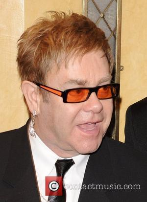 Elton Bonded With Father Over Soccer