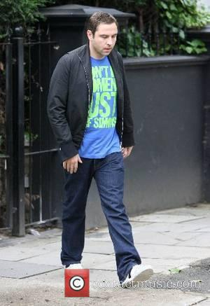 David Walliams leaving his house in a taxi. David then had to return home after he realised he had forgotton...
