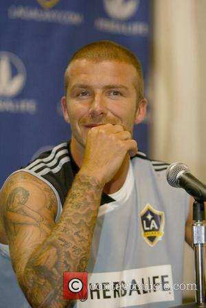 Beckham Beats Kutcher + Phillippe To Sexiest Man Title