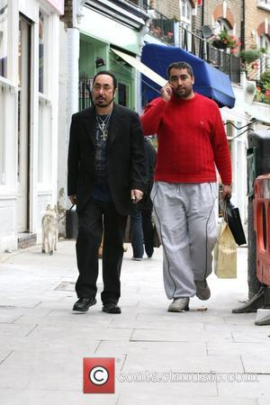 David Gest leaves Tann Rokka home store in Primrose Hill with his bodyguard Imran after allegedly spending �20,000 on a...