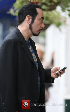 David Gest plays it up for the cameras as he goes for a coffee in Primrose Hill London, England -...