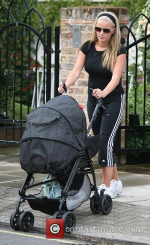 Davinia Taylor leaving her home to take her baby son Grey for a walk in his buggy London, England -...