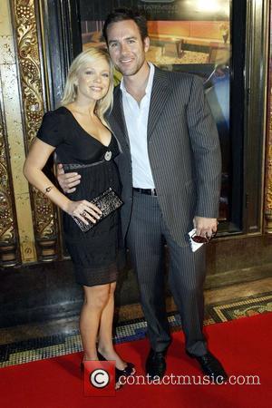 Holly Brisley and Paul Ford