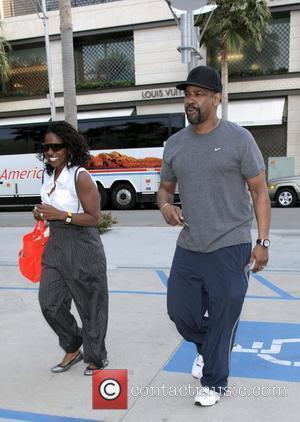 Denzel Washington and his wife Pauletta Washington leave the Grill restaurant in Beverly Hills after eating lunch Los Angeles, California...