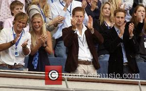 Chelsy Davy, Prince Harry and Prince William watch from the royal box  The Concert for Diana at Wembley Stadium...