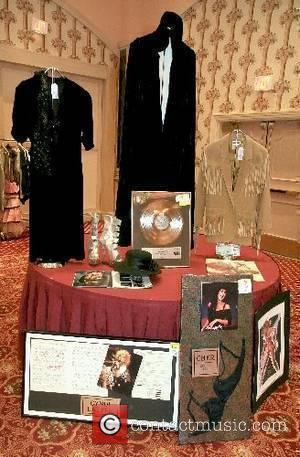 Stevie Nicks, Cyndi Lauper, and Cher display...