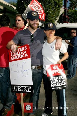 Paul Adelstein and KaDee Strickland Writers Guild of America on strike outside Paramount Studios Los Angeles, Calfornia - 12.12.07