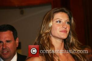 Gisele B�ndchen celebrates the launch of Dolce & Gabbana's newest fragrance 'The One' at Saks Fifth Avenue New York City,...