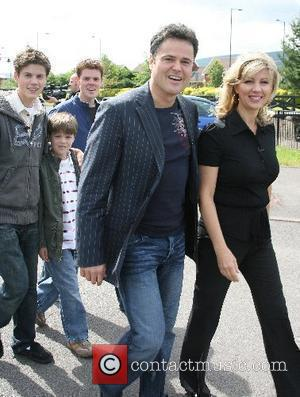 Donny Osmond with wife Debbie Osmond and children visited the 'Joseph Parry Museum' and talked to a local resident that...