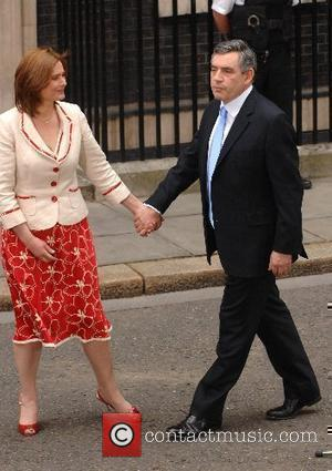 The new Prime Minister Gordon Brown and his wife Sara arrive at 10 Downing Street on his first day in...
