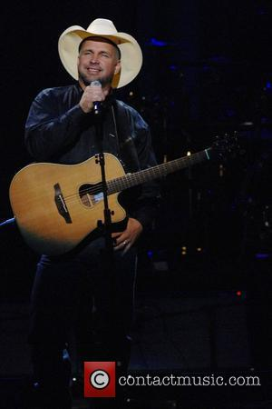 Garth Brooks performs onstage  at the Dream Concert presented by Viacom at Radio City Music Hall New York City,...