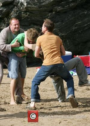 Hugo Speer and Jason Donovan on the set of a new ITV soap opera 'Echo Beach'. In this scene the...