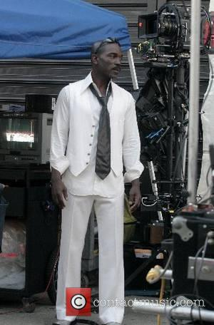 Eddie Murphy's body double on the set of his new movie 'Starship Dave' in Central Park. Eddie's love for children...