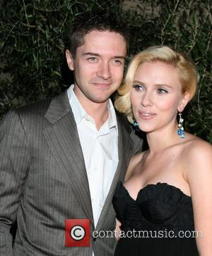 Topher Grace and Scarlett Johansson
