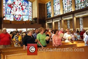 A mass is offered in memory of Elvis Presley at Saint Paul the Apostle Catholic Church. Fans have been walking...