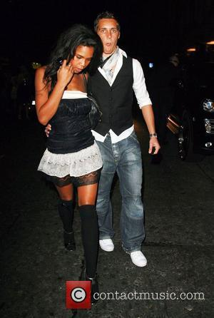 Charley Uchea and boyfriend leaving Embassy nightclub London, England - 22.09.07