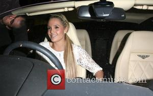 Danielle Lloyd in her new Bentley at Andy Scott-Lee's launch party to release his new single, 'Unforgettable' held at the...