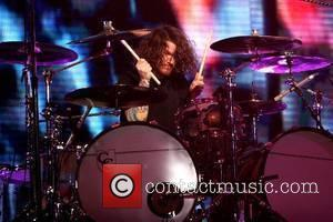 Andy Hurley of Fall Out Boy performs at Jones Beach Theater during the 2007 Honda Civic Tour and celebrates bassist...