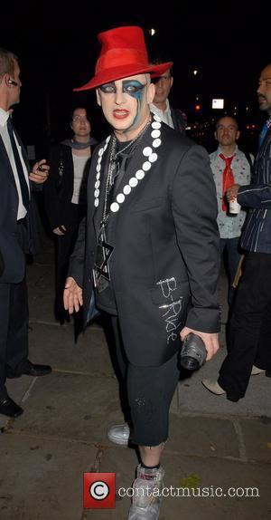 Boy George Arrested On False Imprisonment Charges