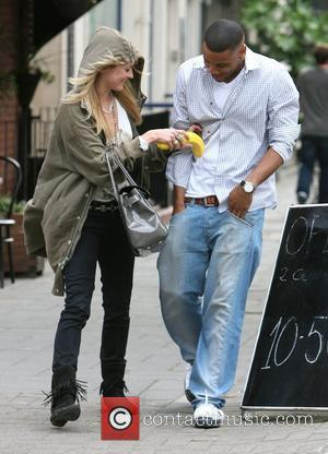 Fearne Cotton, Reggie Yates Leaving The Radio 1 Studios Having Presented Their Saturday Request Show. Fearne Was In A Jolly Mood, Showed Photographers Her ' Banana Guard ' Which Is A Plastic Device Shaped Like A Banana, Designed To Protect The Fruit Against Being Bruised. However When Fearne Attempted To Get Co-host Reggie To Hold The Container, The Only Thing Bruised Was His Ego and As He Was Extremely Reluctant To Join In The Fun!