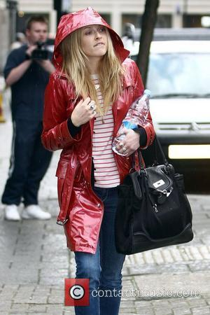 Fearne Cotton braves the rain as she leaves the BBC Radio One studios London, England - 14.04.08