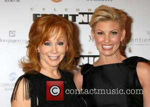 Reba Romps Past The Rappers