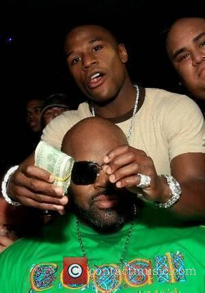 Suge Knight and Undefeated pro boxer 'Pretty Boy' Floyd Mayweather Jr., former WBC lightweight and featherweight world champion and top...